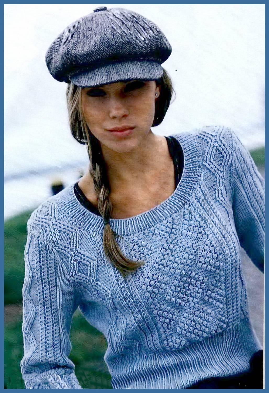 Пуловер с ромбами, связанный на спицах.  В середине короткого пуловера с глубоким вырезом - объёмный узор с...